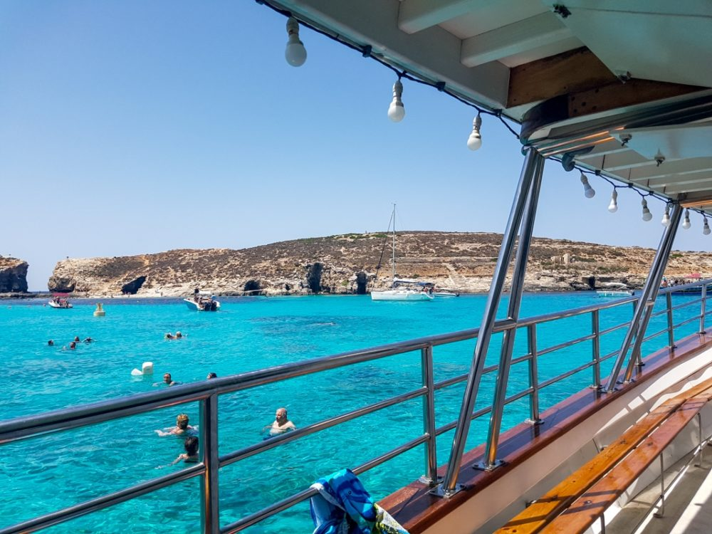 Taking a boat cruise to the Blue Lagoon in Malta
