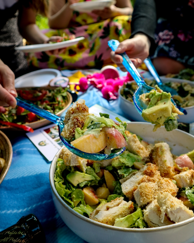 Eating Peach, Avocado and Crispy Chicken Caesar Salad at a garden party | Mini Adventures