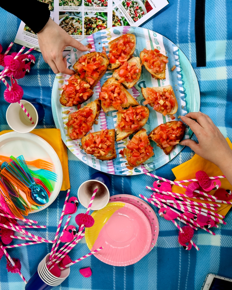 Sharing plate of tomato bruschetta at a garden party | Mini Adventures