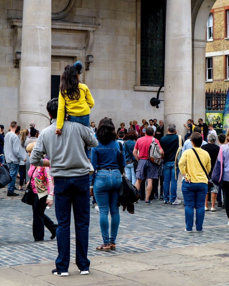 Girl on man's shoulders in Covent Garden | Where to take photos in London | Mini Adventures