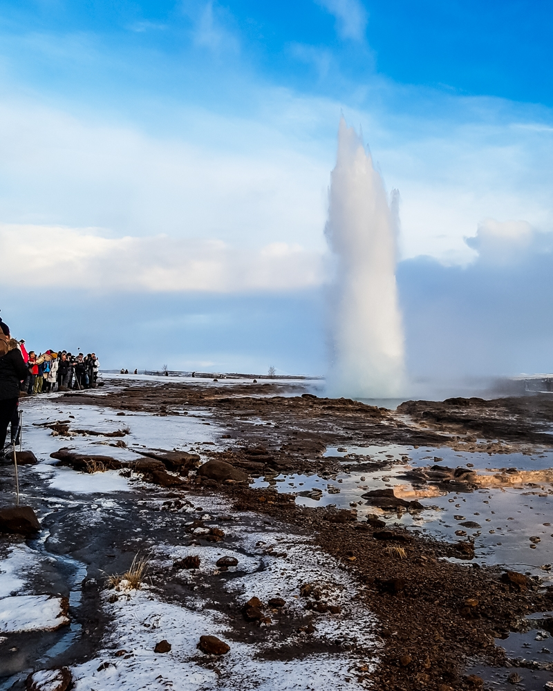 Strokkur geyser erupting at Geysir on a Golden Circle tour, Iceland | Pictures of Iceland in Winter #iceland #winterphotography #europe #nordiccountries #kinfolk