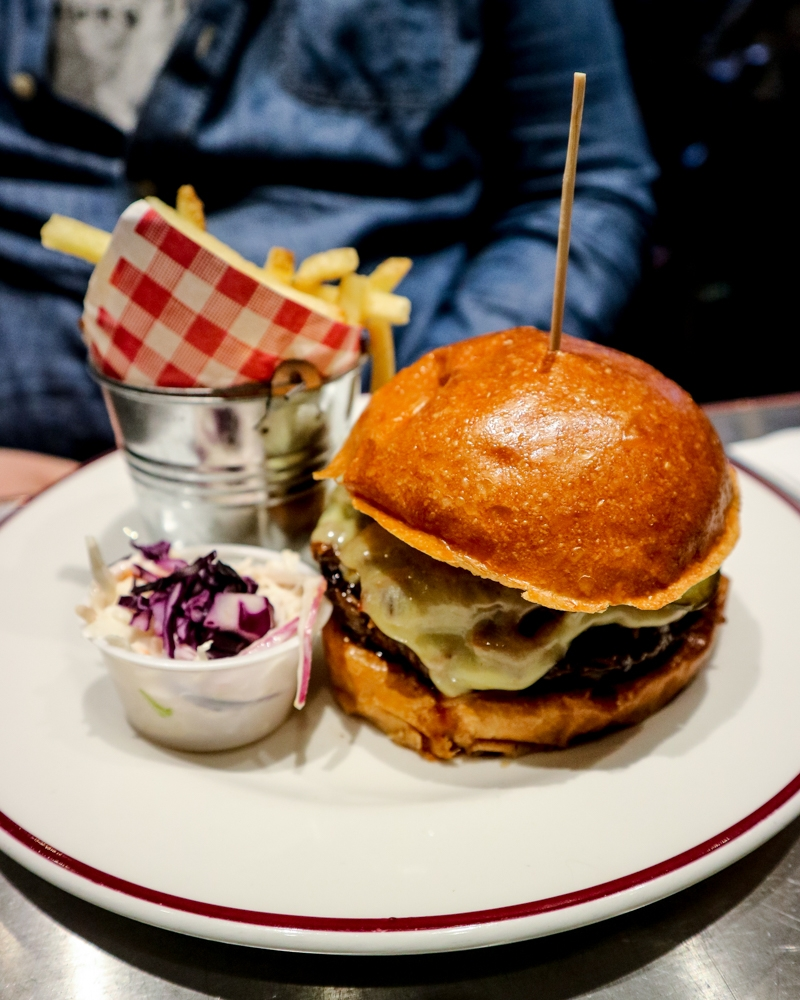 The Piggy Back Burger, fries and slaw at Bill Wyman's Sticky Fingers restaurant, Kensington, London
