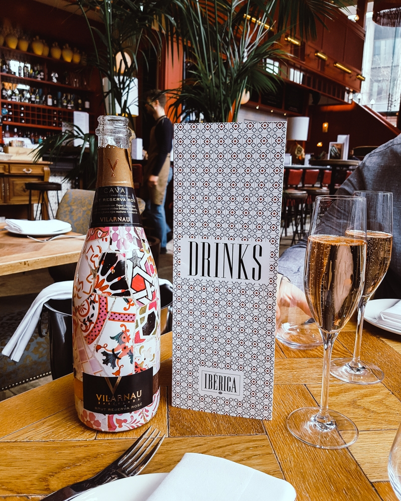 Bottle of pink cava and drinks menu at Ibérica Spanish tapas restaurant Manchester