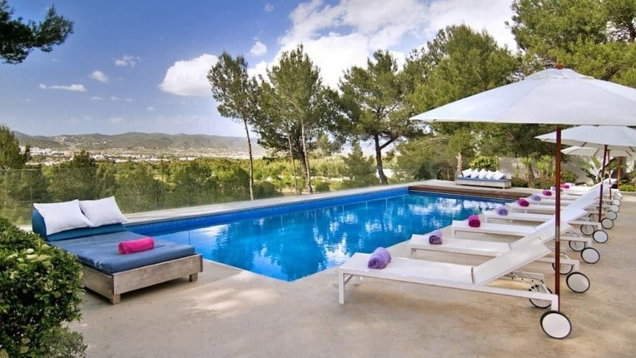 Swimming pool outside a villa in Ibiza | Where to go on a girls' holiday in Europe