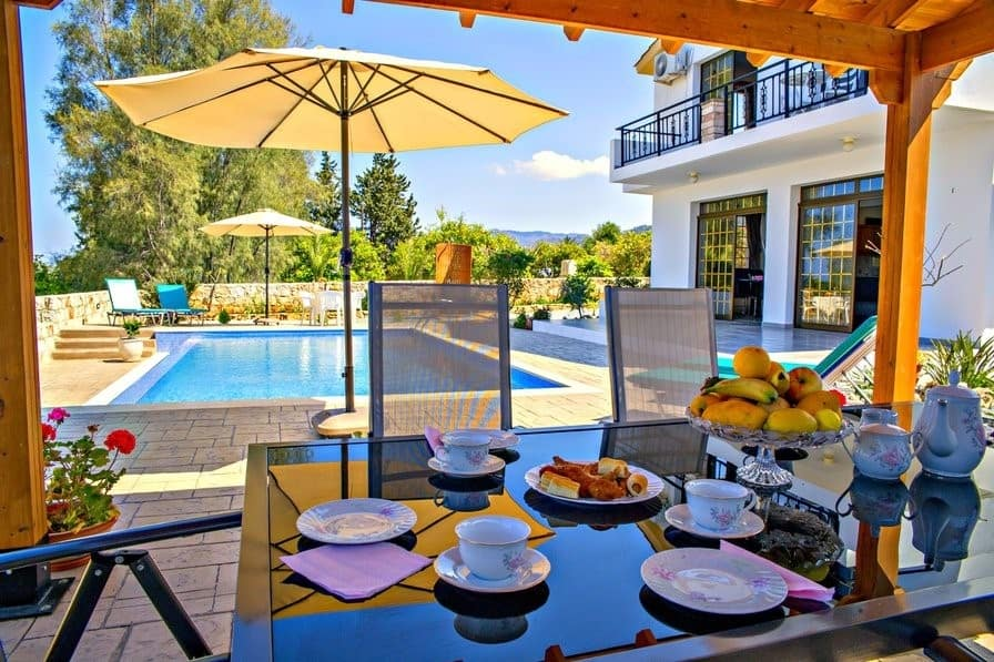 Breakfast table outside villa in Paphos, Cyprus | Where to go for a girls' holiday in Europe