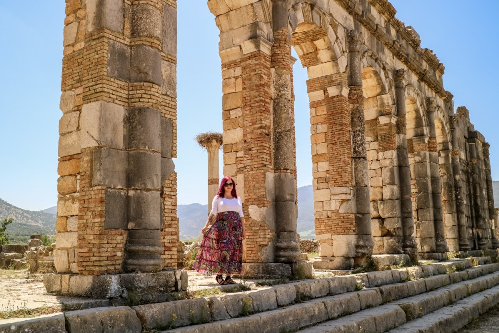 Standing in the ruins of Volubilis, Morocco | Guide to Volubilis archaeological site