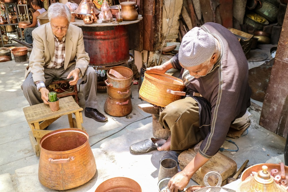 Craftsmen at work in Seffarine Square, Fes el Bali | Places to visit in Fez