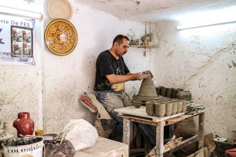 Man making pottery in Mosaique Et Poterie De Fes | Places to visit in Fez