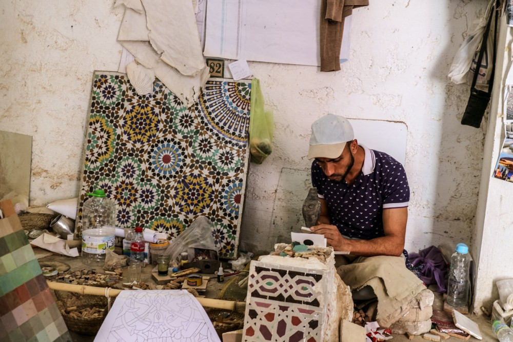 Man decorating pottery in Mosaique Et Poterie De Fes | Places to visit in Fez