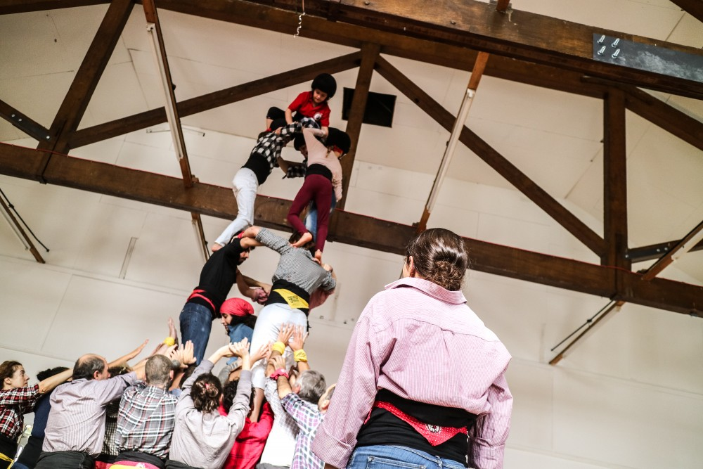 Adults and children taking part in a Catalunyan castell rehearsal in London