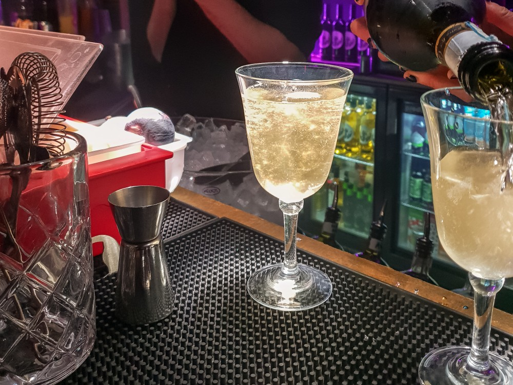 Prosecco cocktail on the bar | Divine Proportions review, London