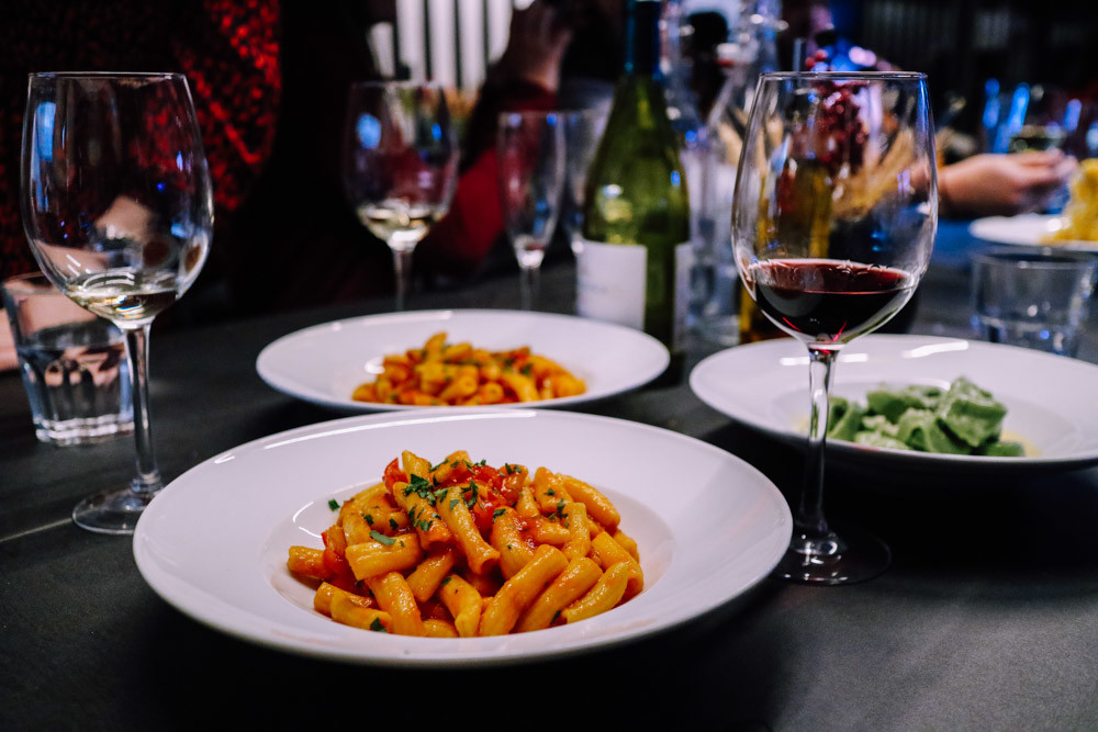 Bowls of pasta with a glass of red wine in a London Italian restaurant