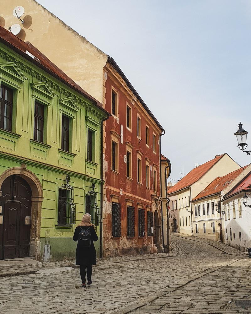 Girl walking down oldest street in Bratislava
