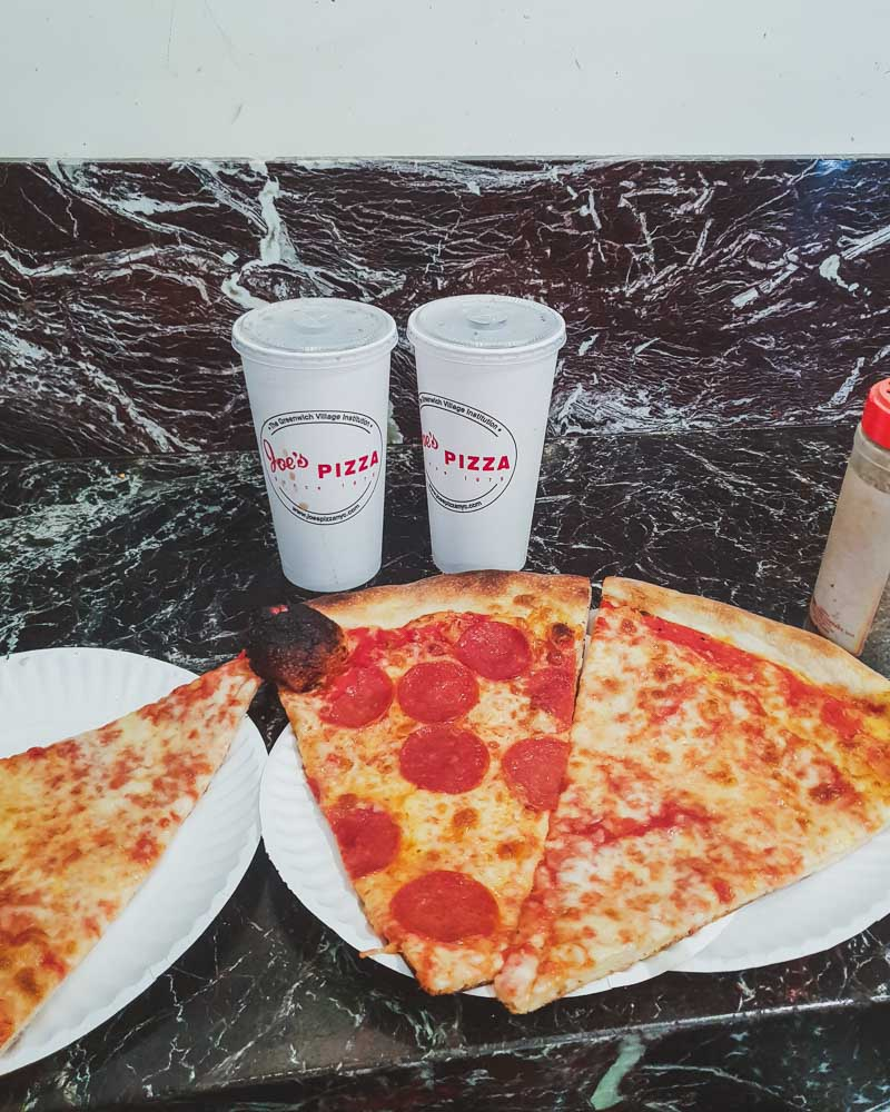 Three slices of pizza and drinks