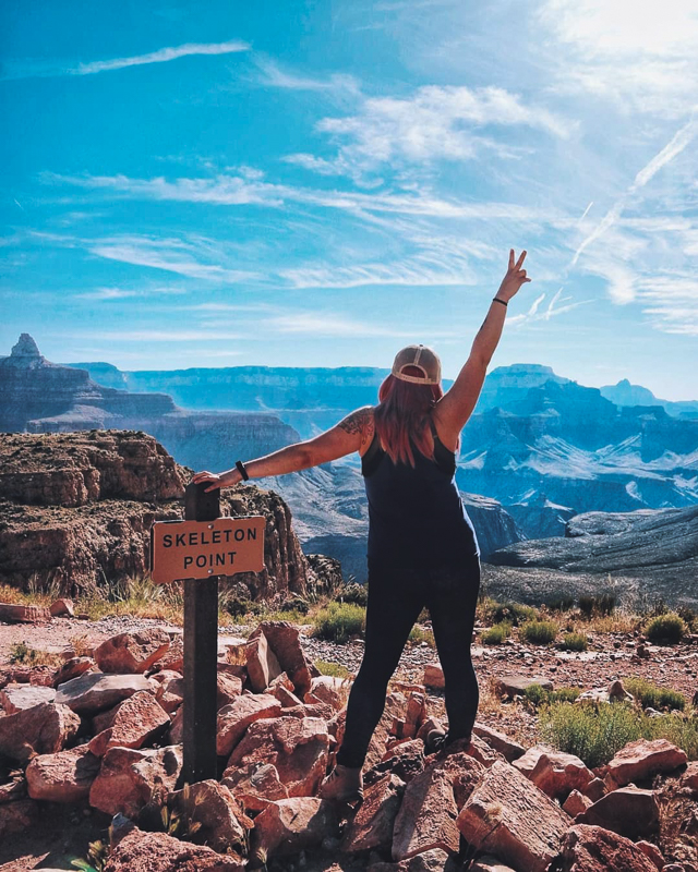 Girl standing by Skeleton Point sign at the Grand Canyon