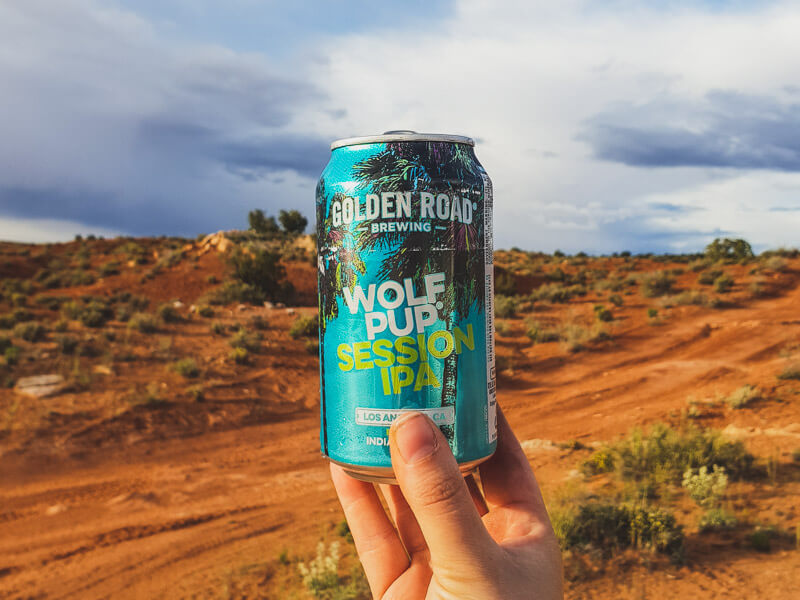Can of Wolf Pup IPA being held up