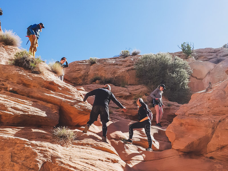 Group climbing on canyon rocks