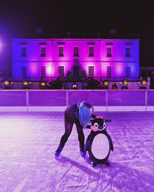 Girl with penguin at Ice Rink at Queen's House Greenwich